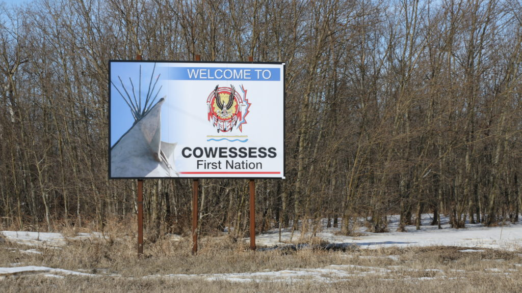 A sign welcomes visiters and residents to Cowessess First Nation at the edge of the community in Saskatchewan on March 6, 2020. Photo by Adam Bent.