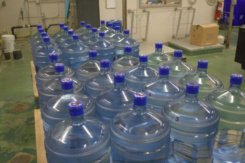 Jugs of bottled water wait to be distributed to Cowessess First Nation community members on March 6, 2020. Photo by Libby Giesbrecht.